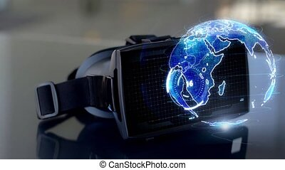 vr headset with 3d hologram of earth planet