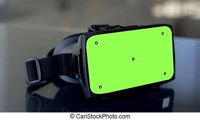 vr headset with green screen on table - virtual, technology...