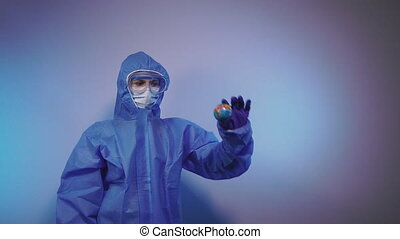 Virus. A doctor in a protective medical suit against the virus throws a ball in the form of a planet of the earth.