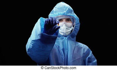 Virus. A woman in a protective antivirus suit holds a virus ...