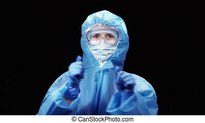 Virus. A woman in a protective antivirus suit is dancing to the music.