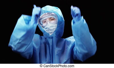 Virus. A woman in a protective antivirus suit is dancing to ...