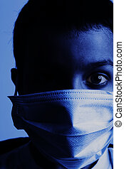 young boy with health mask for is protection again virus. Tinted in blue with high contrast