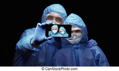Virus. Man and woman in protective antivirus suit take ...