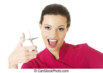 Visage artist holding scissors - Happy visage artist holding...