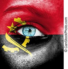 visage femme, peint, à, drapeau, de, angola