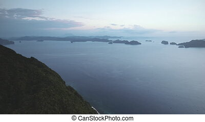 Visayas archipelago islands silhouette at ocean bay aerial. Hilly isles at serene water surface. Amazing seascape with calm and relax sea gulf. Cinematic summer evening of tropical paradise scenery
