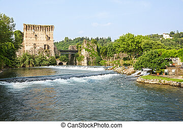 Visconti bridge of Valeggio sul Mincio at Borghetto with reflections in Mincio river, Italy