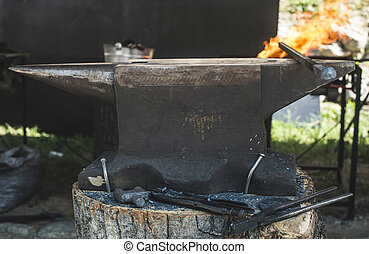 Vise and anvil in a forge shop