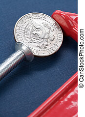 Vise Grip and coin close up