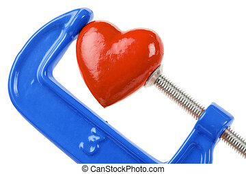 Vise Grip and red heart, concept of stress, sadness, heart ...