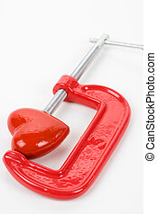 Vise Grip and red heart, concept of stress, sadness, heart...
