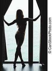 visión trasera, de, atractivo, atractivo, delgado, mujer, silueta