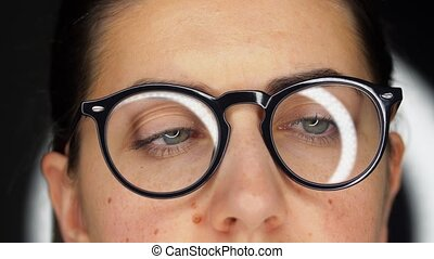 close up of woman's face or eyes in glasses - vision and ...