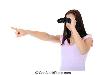 Vision - Attractive teenage girl using spyglass pointing...