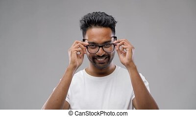 indian man or student taking his eyeglasses off - vision,...