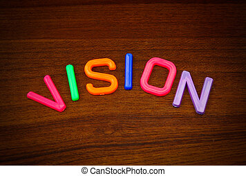 Vision in colorful toy letters