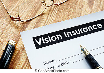 Vision Insurance application form and glasses.