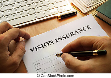 Vision insurance policy on a office table.