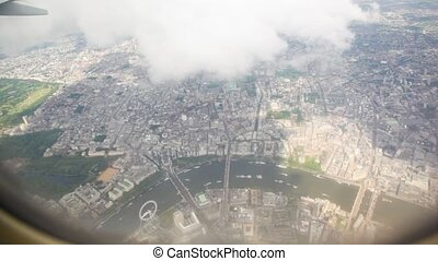 vision of London city from  airplane flying high over it