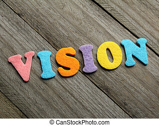 vision word on wooden background