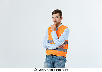 Visionary architect or engineer looking up and thinking about new projects. Wearing reflective vest isolated on white background.