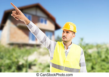 Visionary architect or engineer showing and pointing finger up