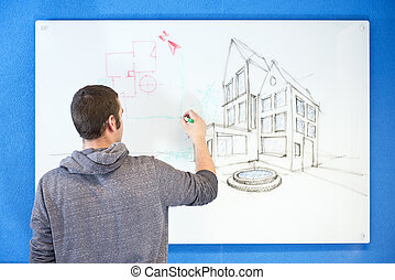 visionary architect - Young architect, drawing ideas, plans ...