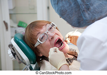 visit at the dentist - Mature woman during visit at the...