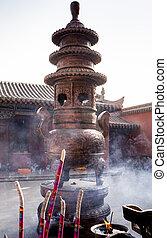 Visiting Chinese Buddhist tample, smoking incense sticks