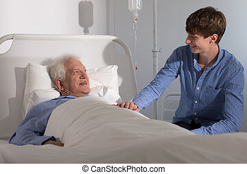 Visiting grandfather in hospital - Grandson is visiting his...