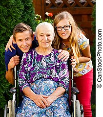 Teenager grandchildren visiting their old disabled grandmother.