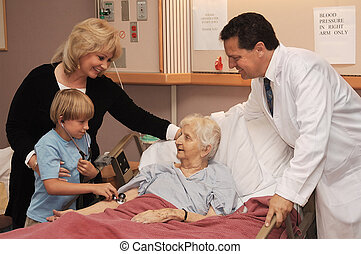 visiting nursing home - mother, son and doctor visiting...