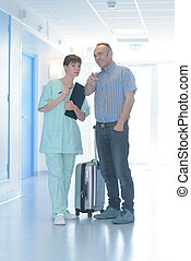 visitor asking the nurse for direction