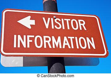 Visitor Information sign against blue sky