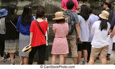 Visitor listens their tourist guide