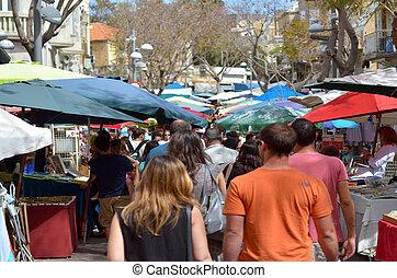 Visitors in Nachalat Binyamin Pedestrian Mall in Tel Aviv,...