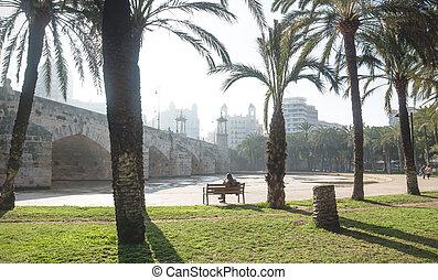 Visitors in the Turia river park under the Puente del Mar, Valencia, Spain