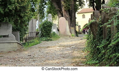 Visitors of Cemetery - Tourists come rushing to enter the...