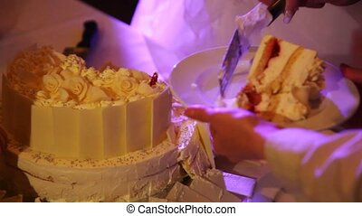 Visitors on wedding cut wedding pie and put it on plates
