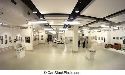 Visitors photograph and walk on Museum - exhibition center...