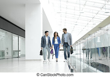 visitors walk in the lobby of the business center