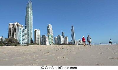 Visitors walks on main beach in Surfers Paradise Gold Coast...