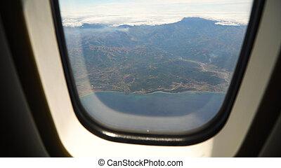 vista, de, un, ventana avión, en, el, ocean.