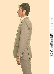 vista, guapo, caucásico, hombre de negocios, perfil