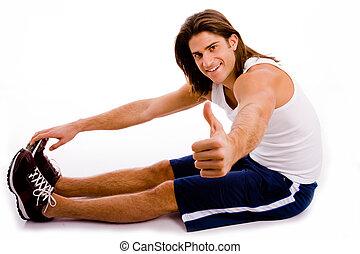 vista lateral, de, ejercitar, hombre, con, pulgares arriba