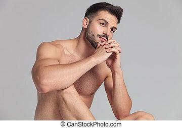 vista lateral, de, un, sentado, nked, hombre, rezando