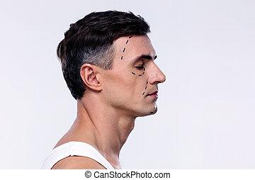 vista lateral, retrato, de, un, hombre, marcado, con, líneas, para, cirugía plástica