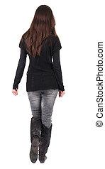 vista posteriore, di, andare, donna, in, jeans, e, maglione