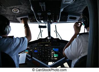 vista posteriore, di, pilota, e, copilota, in, abitacolo